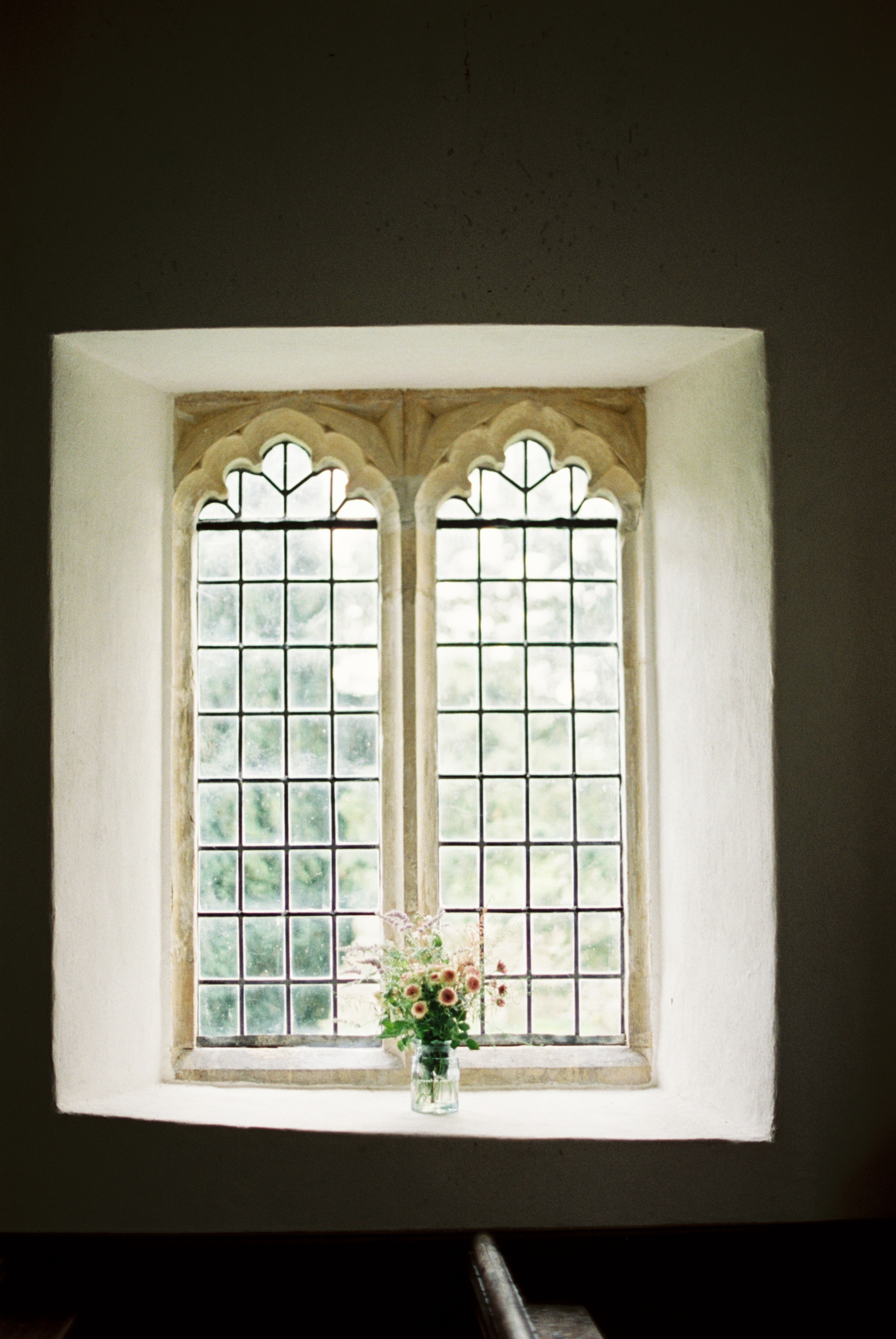 Interior-church-window-and-sill-with-flowers
