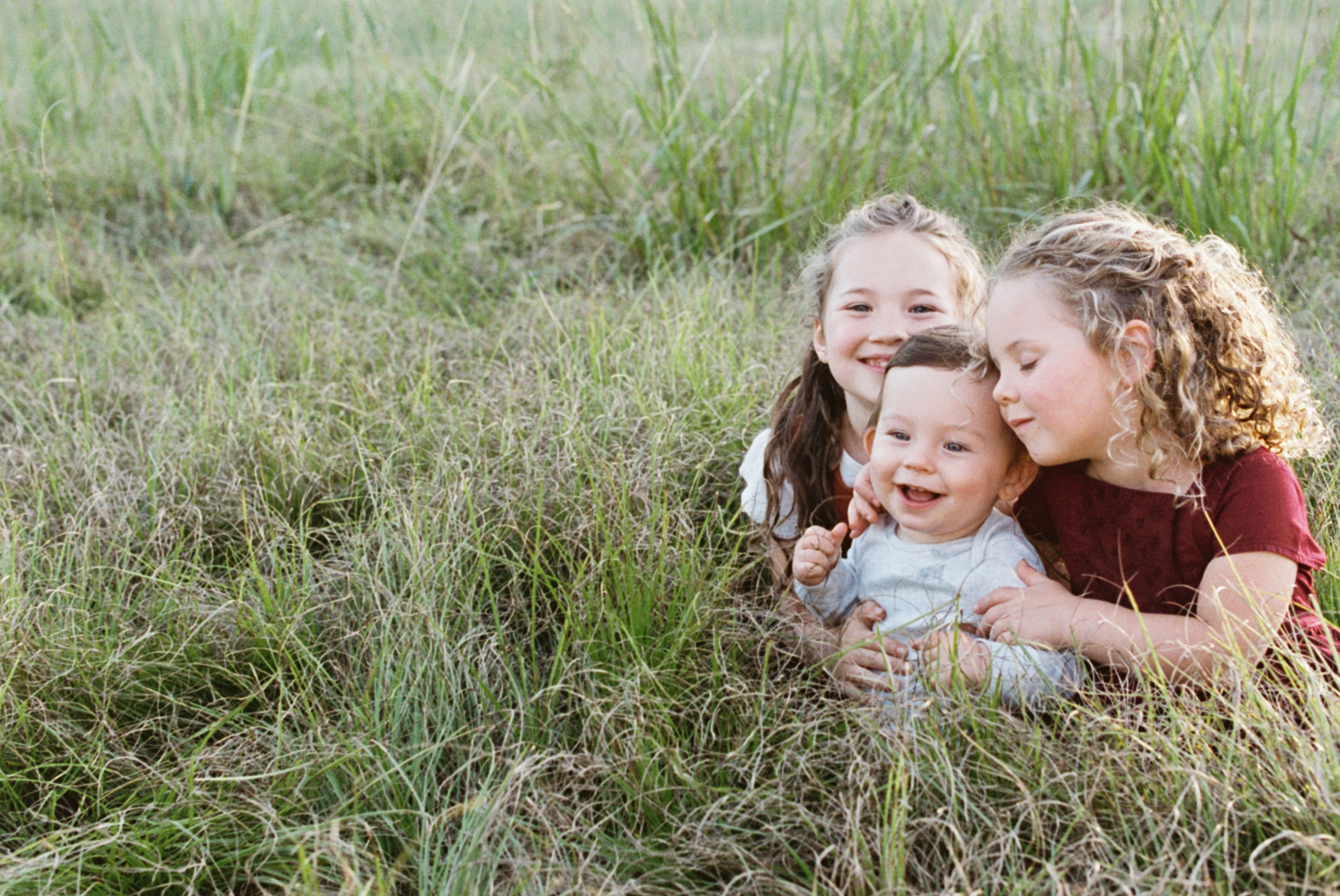 three-kids-in-a-field